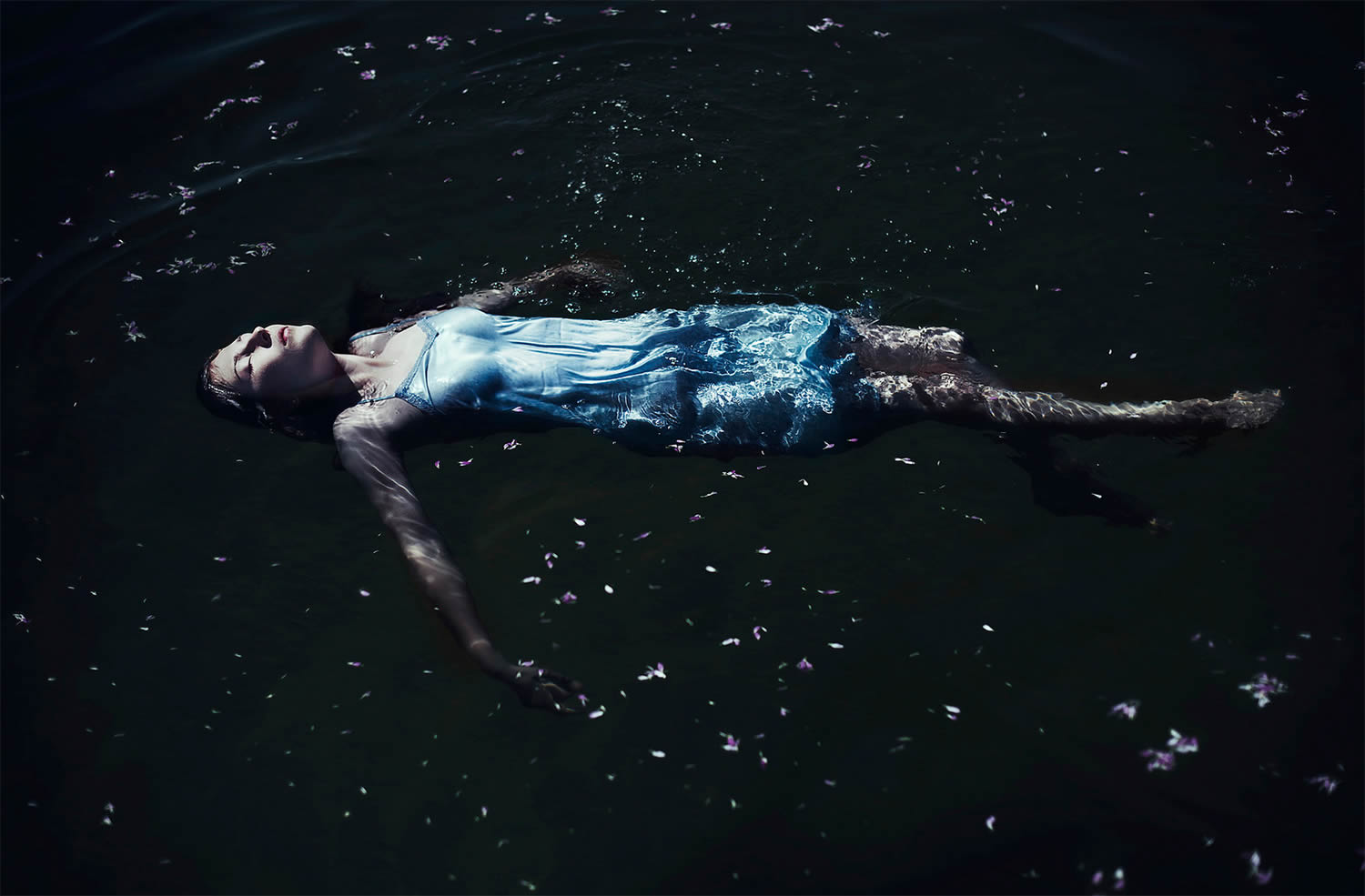 woman laying in water, photography