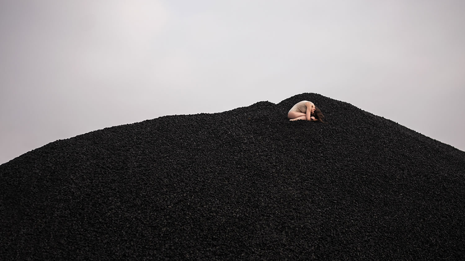 woman in coal field, photography