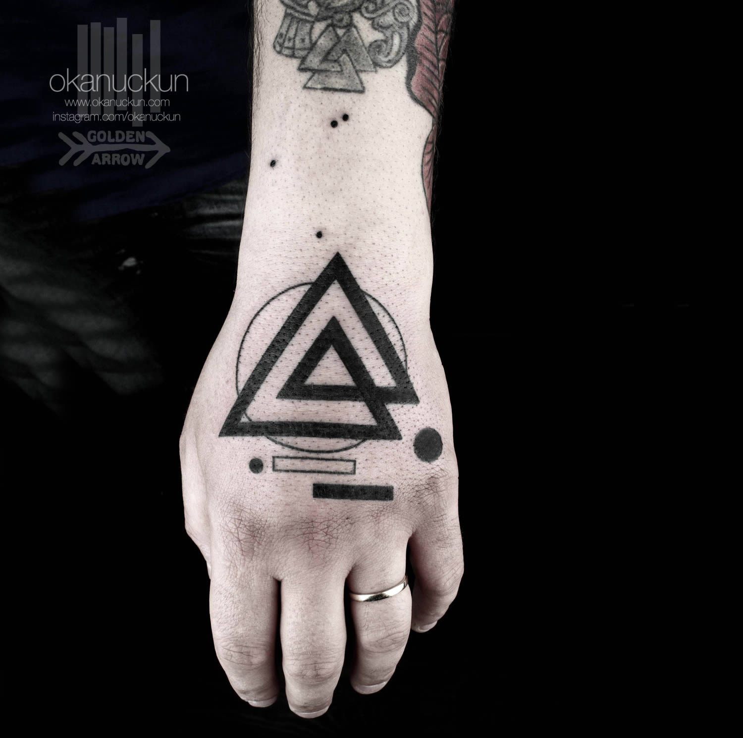 modern triangle on hand, tattoo