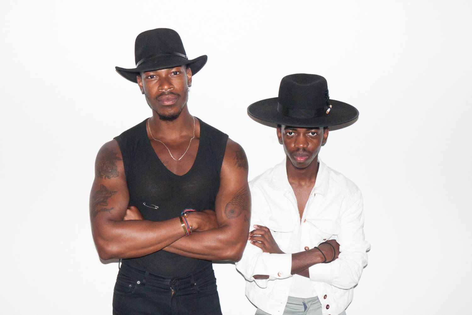 two men posing with hats, photo