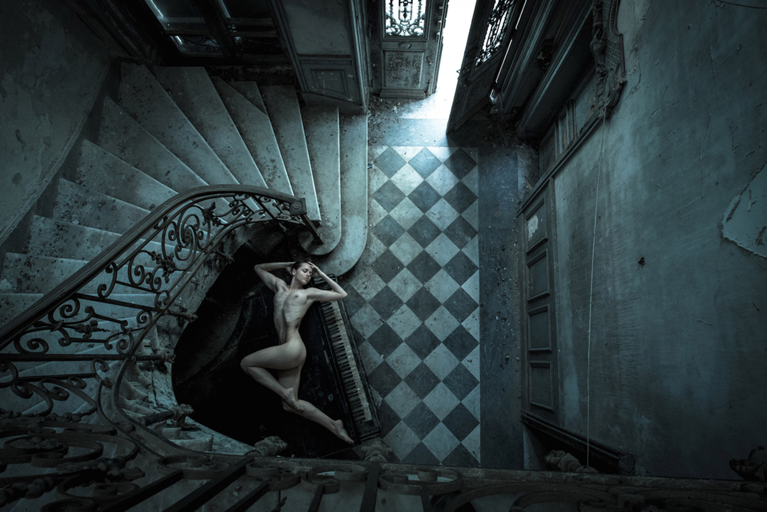Jeremy Gibbs, Ayla in Decay, nude model lying at the bottom of dark stairs