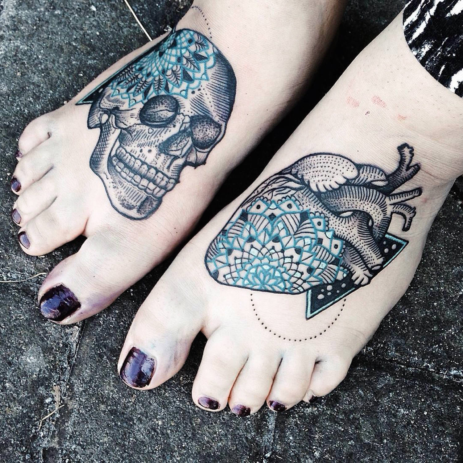 skull and heart tattoos on either foot