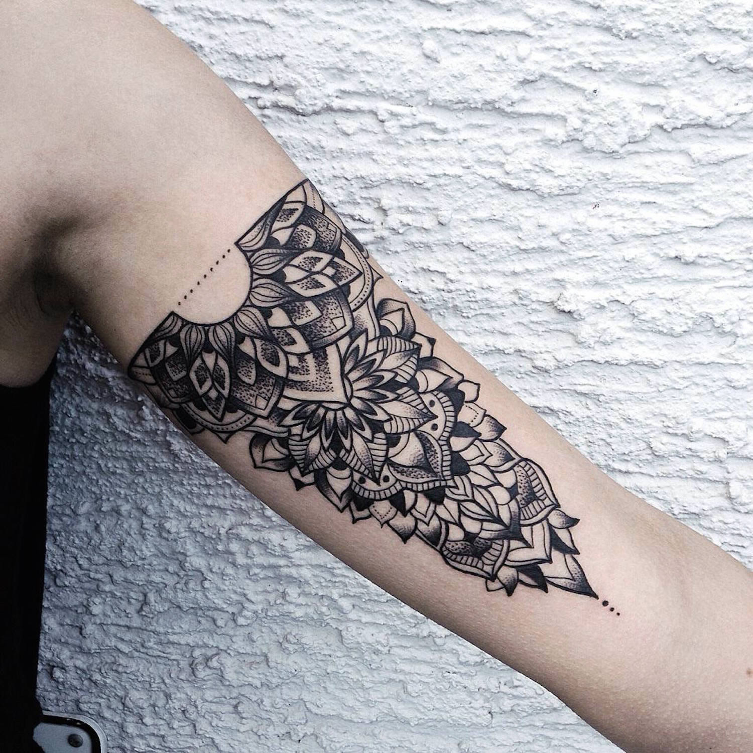 Ornamental tattoo on inside arm