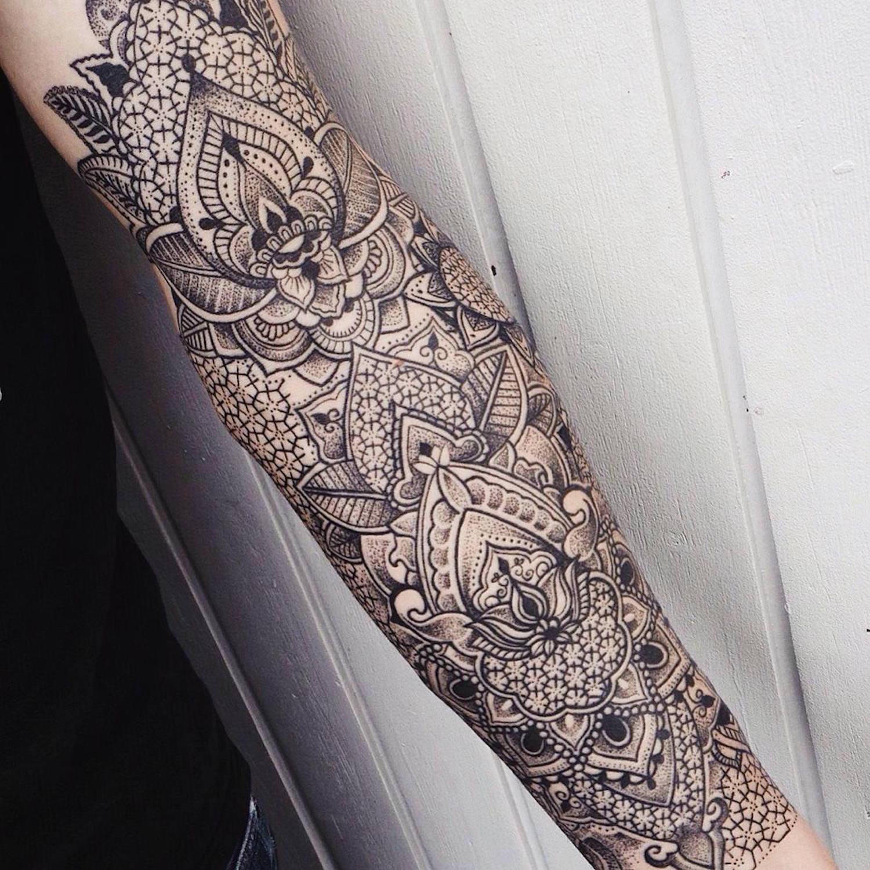 sprawling ornamenta tattoon on the inside of the arm