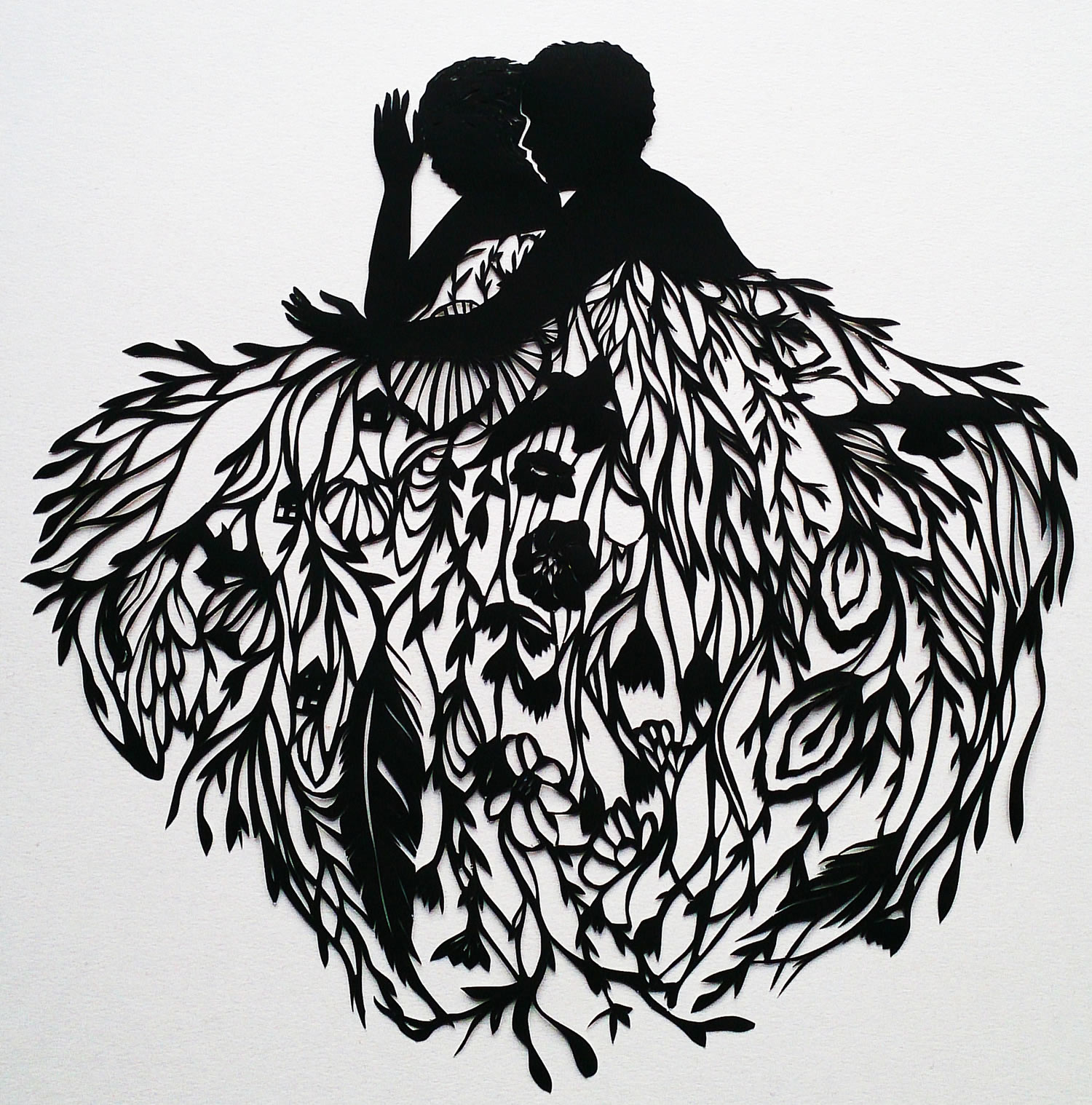 two silhouettes cut out of paper