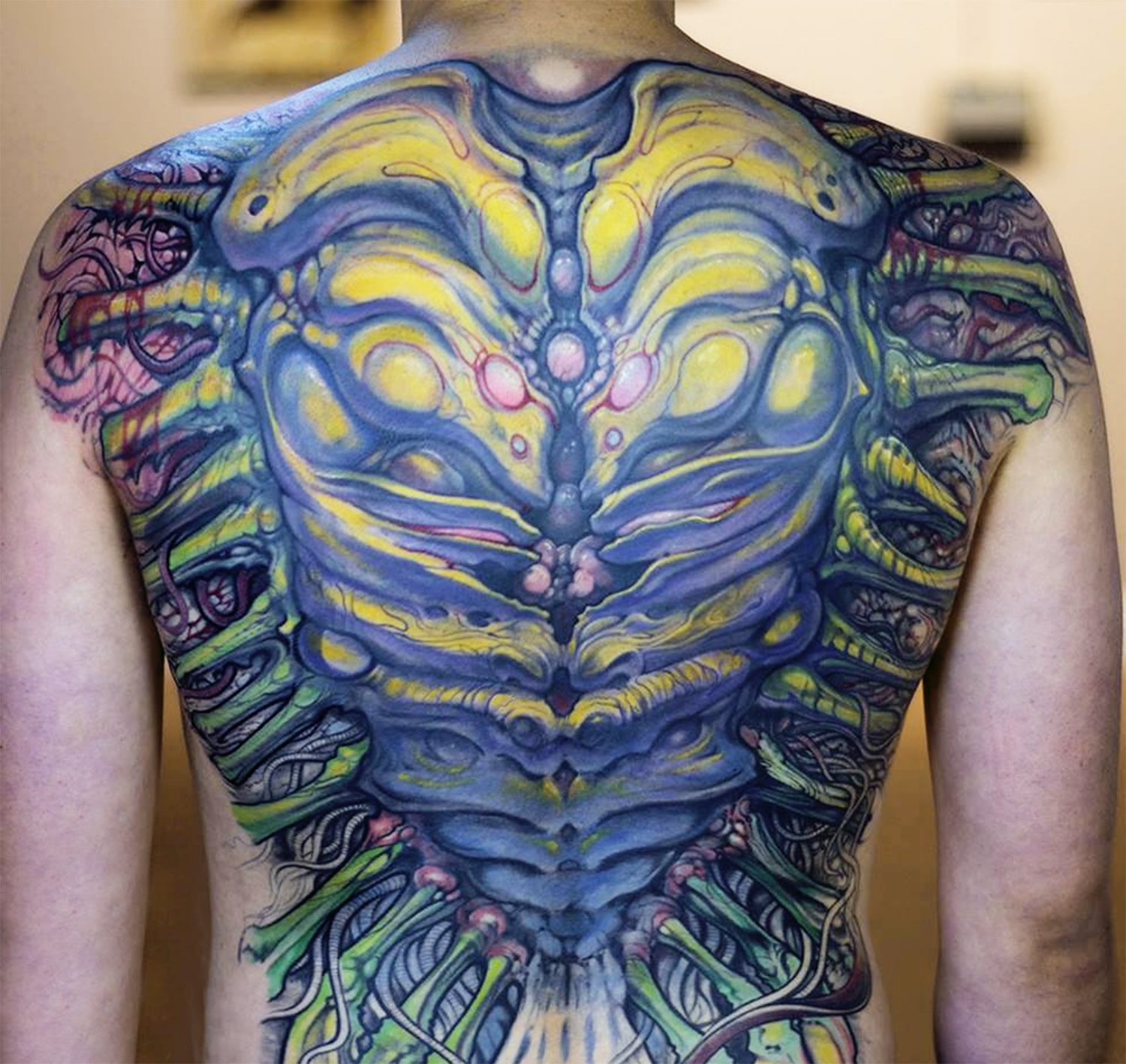 biomech tattoo on back by paco dietz
