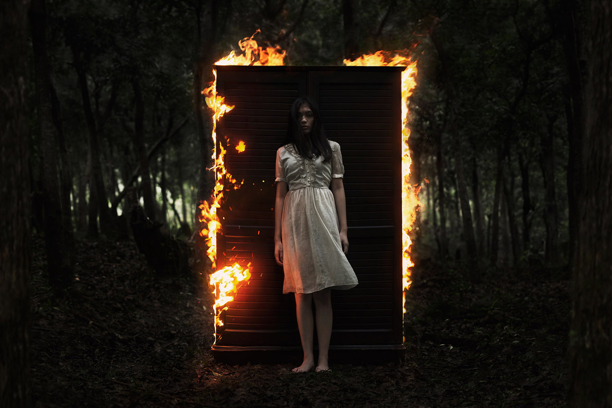 Mikael Aldo, fiery door, eerie woman