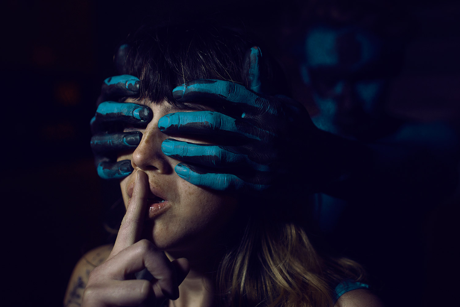 Kavan the Kid, model Lauren Kopp, dark photo with hands over a woman's eyes