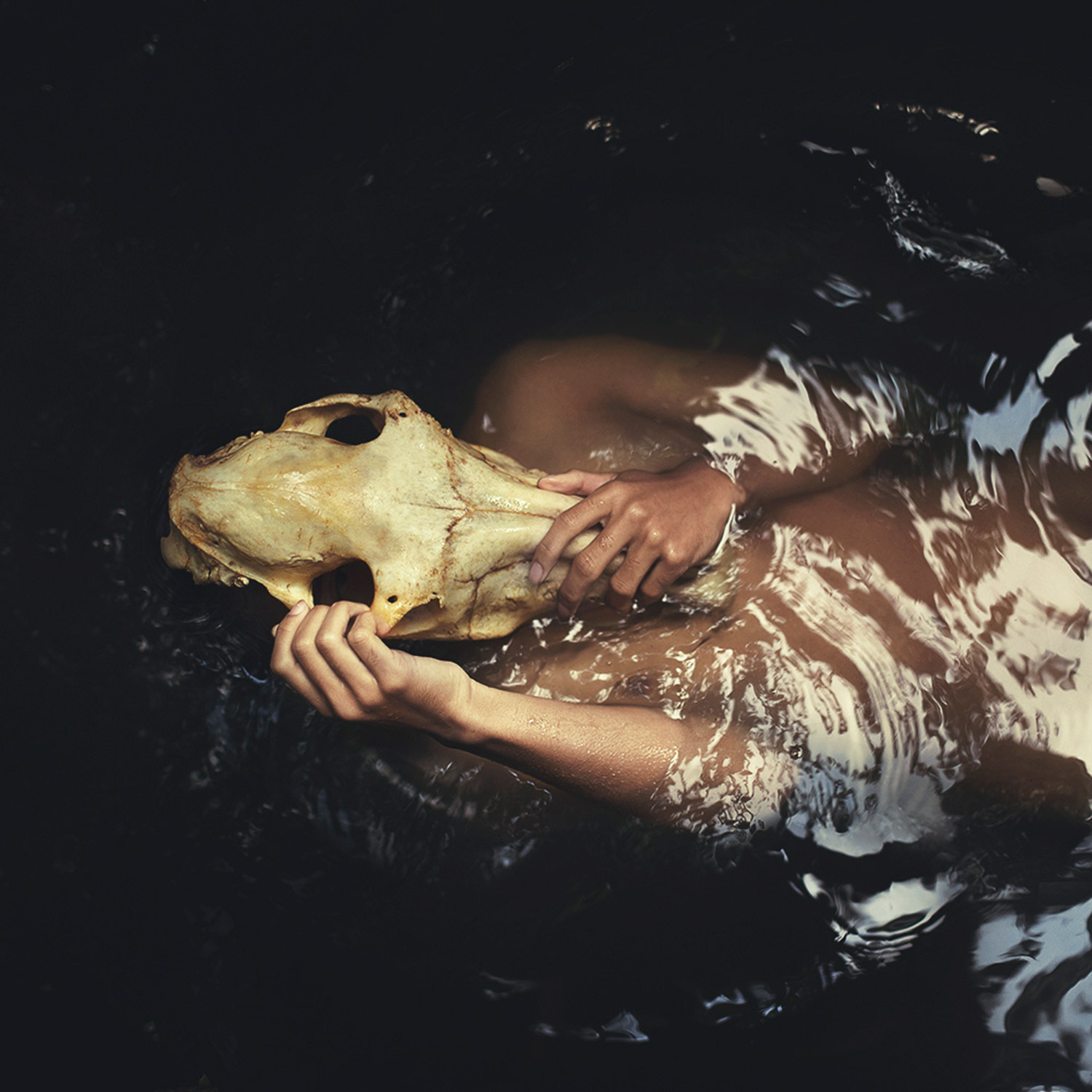 Mikael Aldo, skull-faced boy under water
