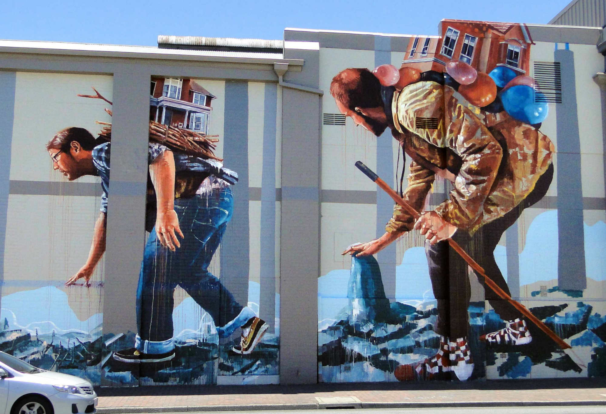 Close up of Fintan Magee migration street art in Perth