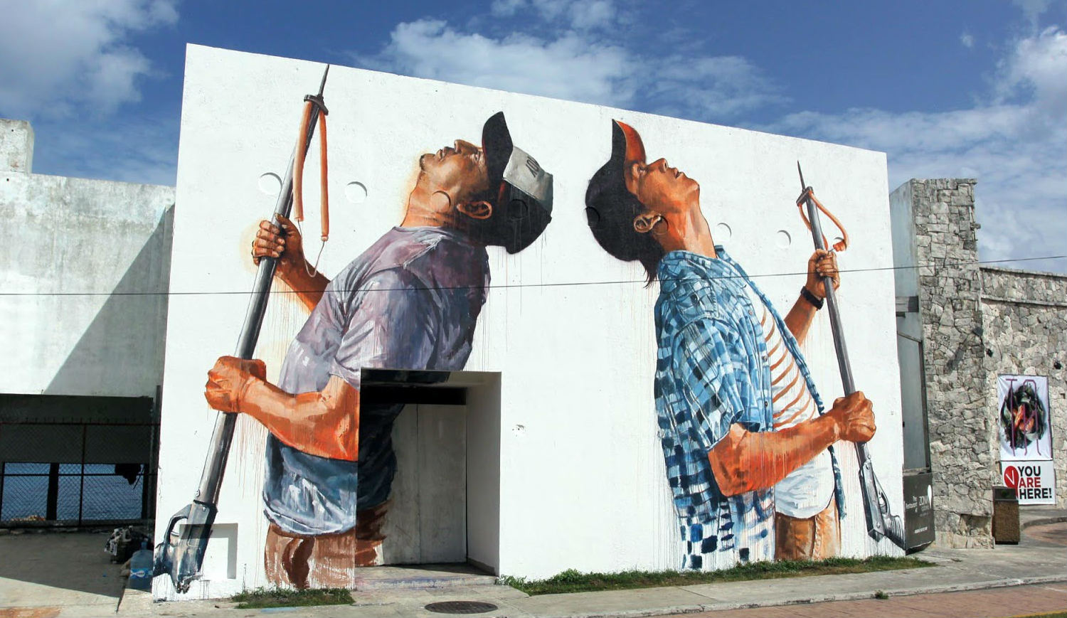 Fintan Magee spearfishing street art in Mexico