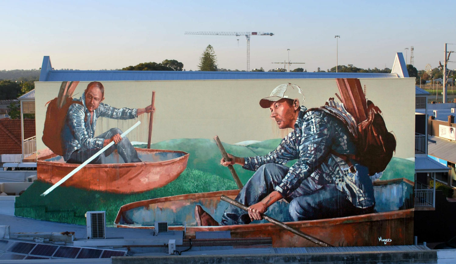 Fintan Magee boating street art in Perth