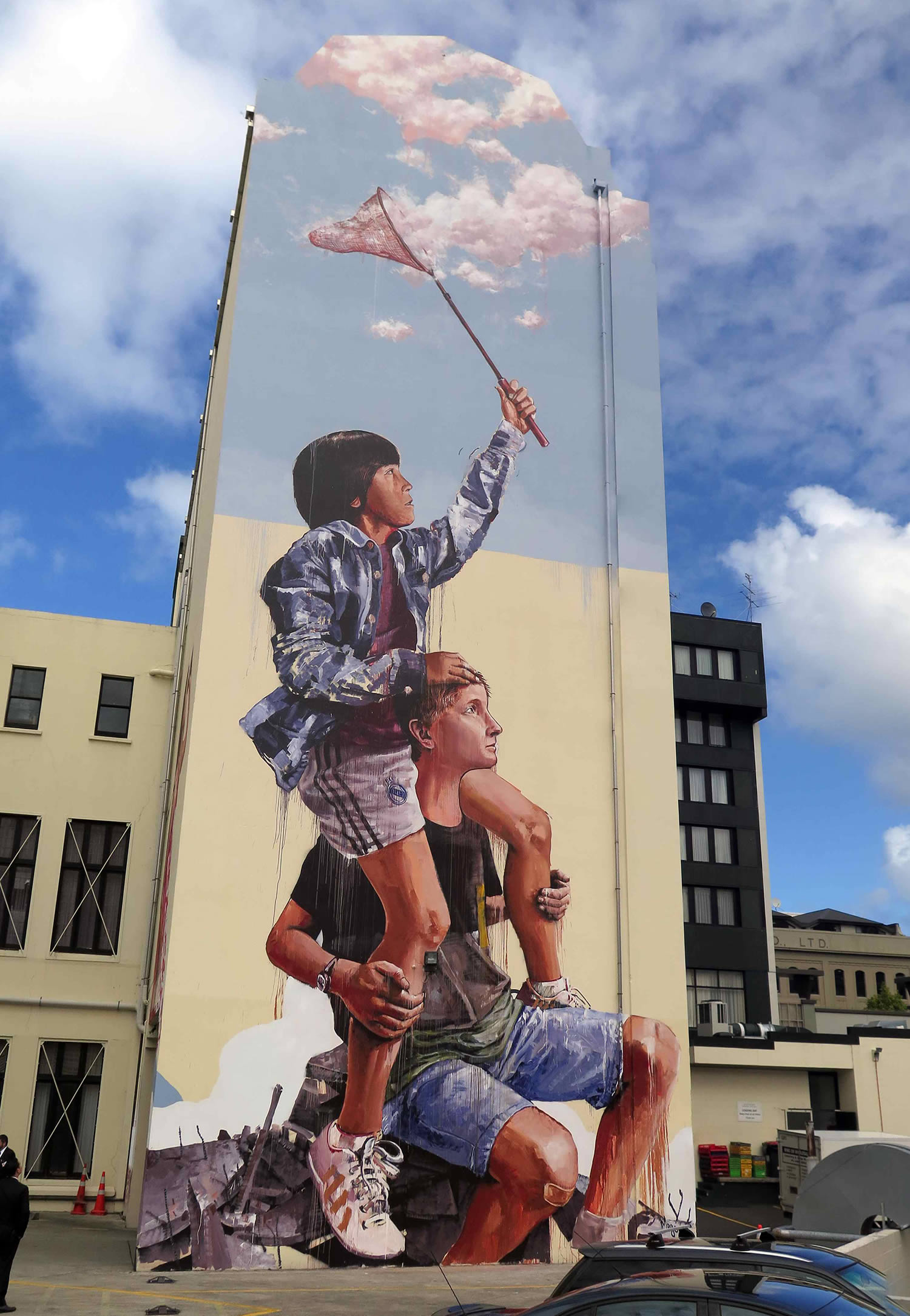 kid fishing for clouds, mural by fintan magee