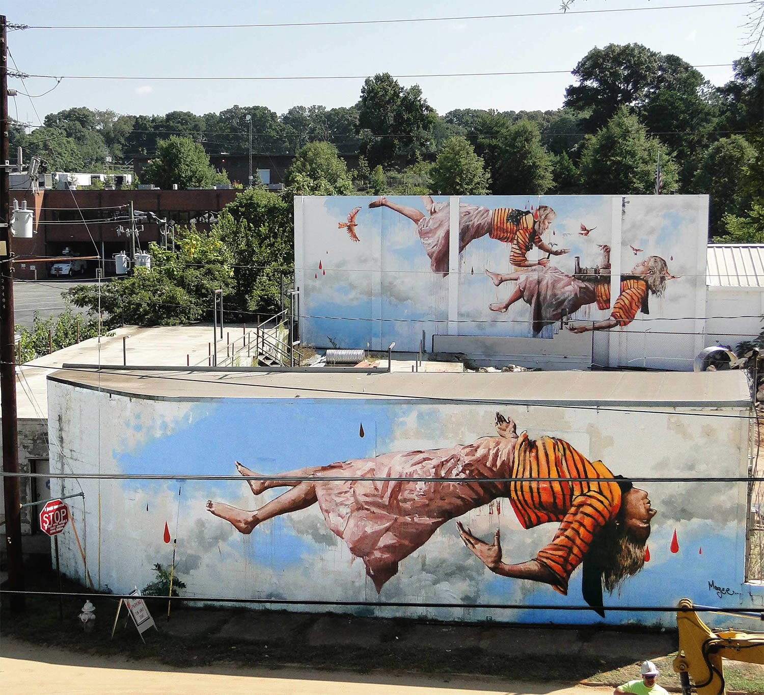 woman suspended in air, swimming in clouds, painting on building wall