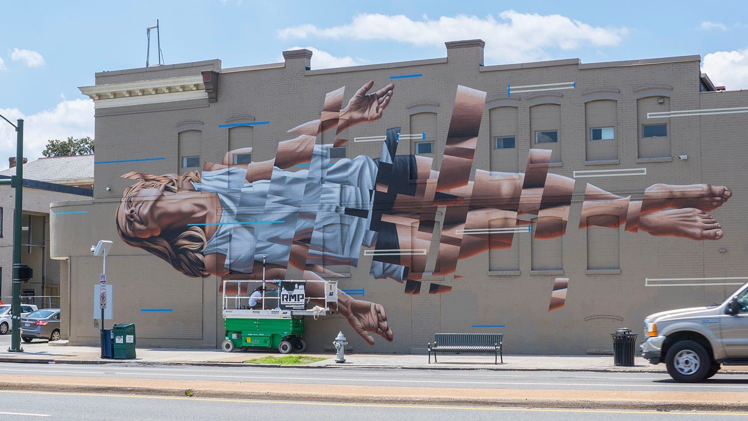segmented street art of a woman in richmond by james bullough