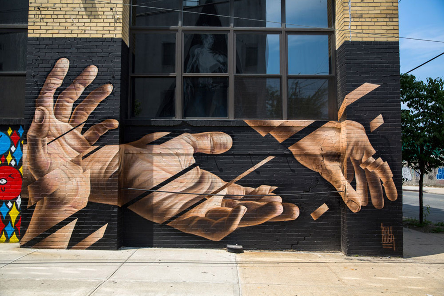 segmented hands mural by james bullough