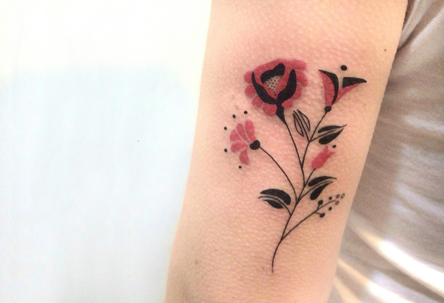 Russian flower tattoo by Brunella Simoes.