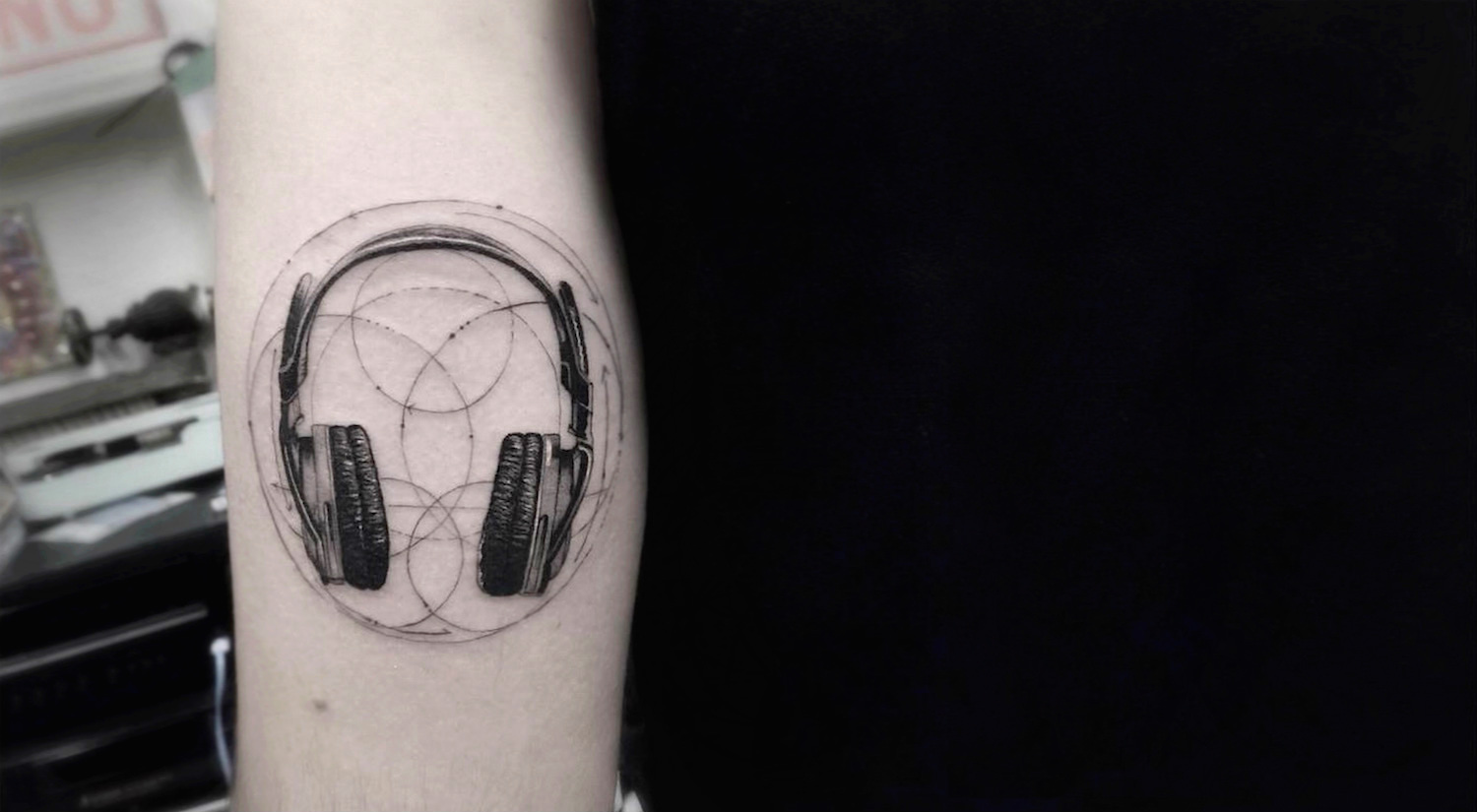 Headphones tattoo by Dr Woo.