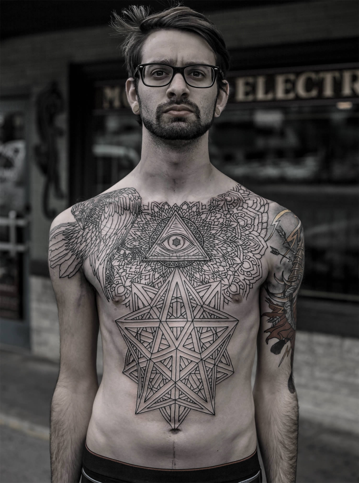 Eye of providence in tattoo chest piece by thomas hooper