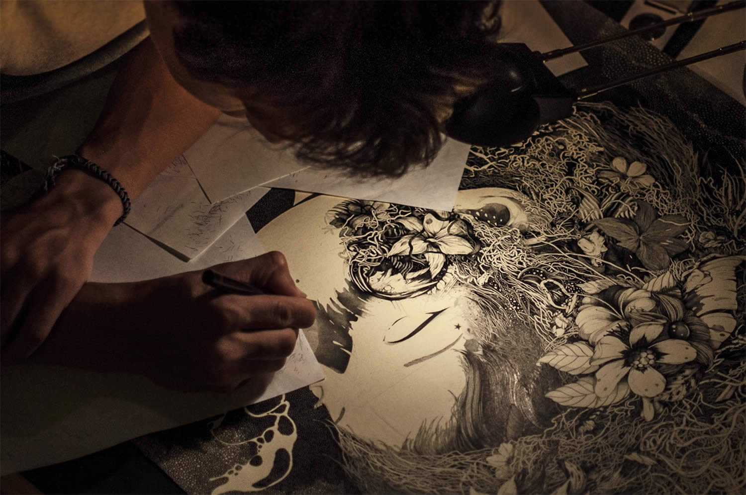 artist benze drawing in his studio