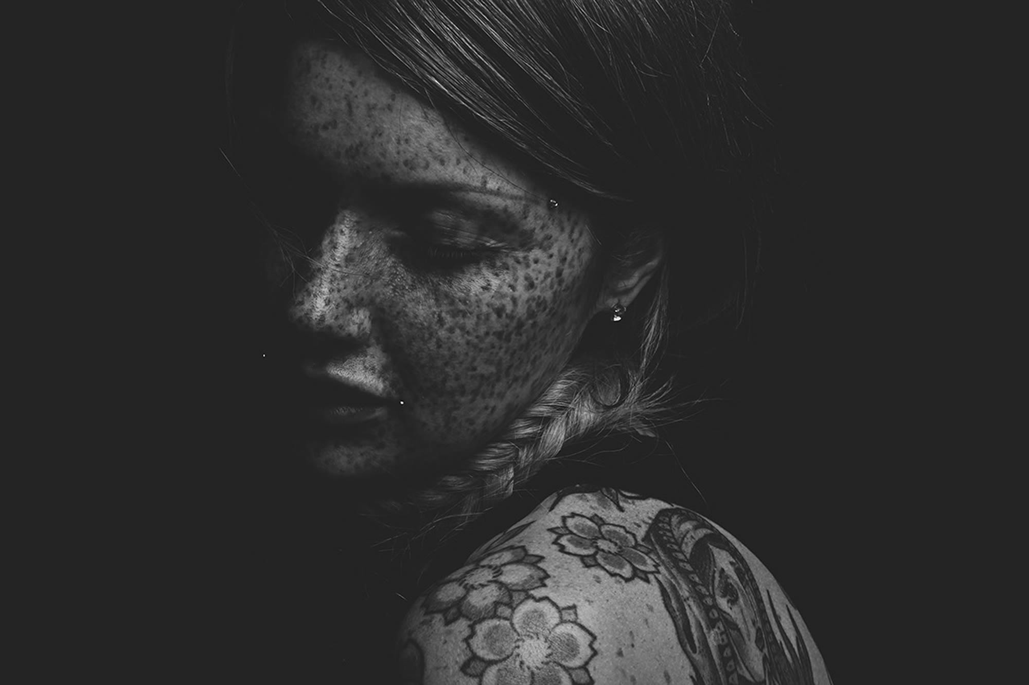 freckled face girl. tattooed body