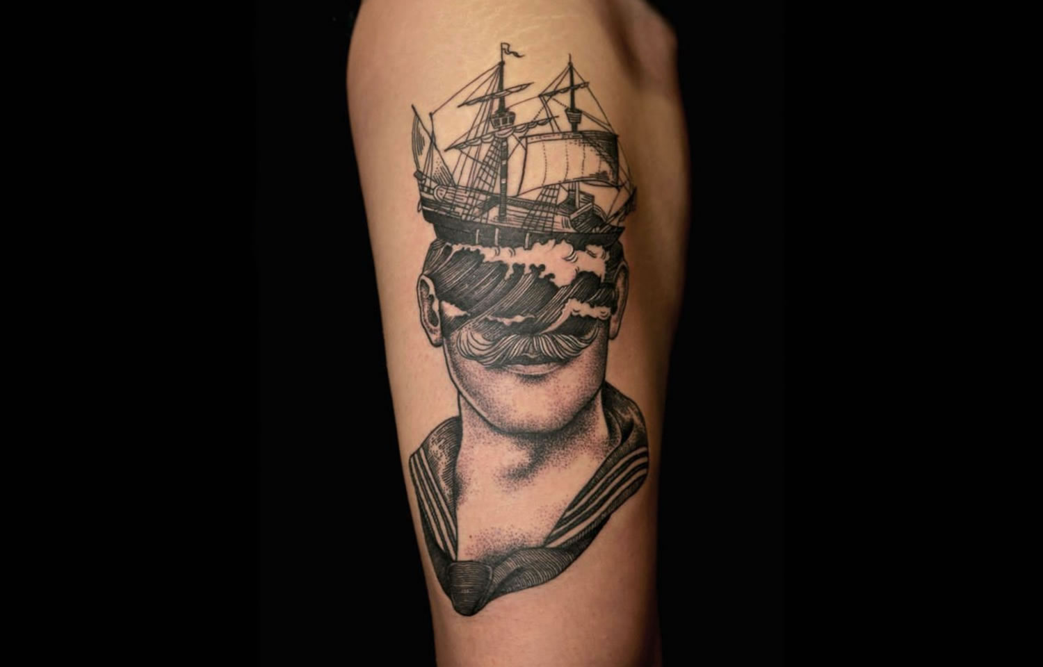 ship on head, tattoo of a moustache man
