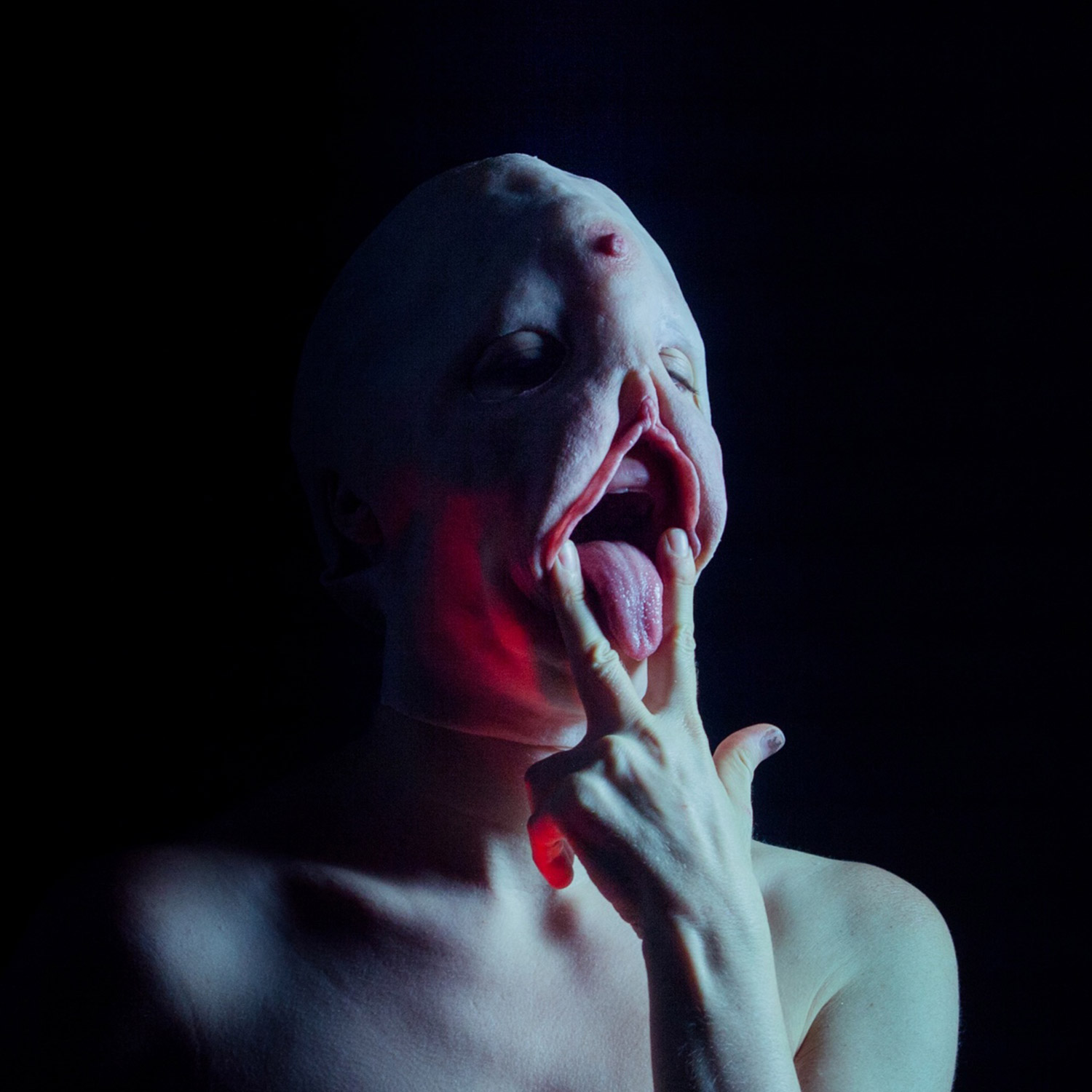 Sarah Sitkin, human wearing creepy silicone mask