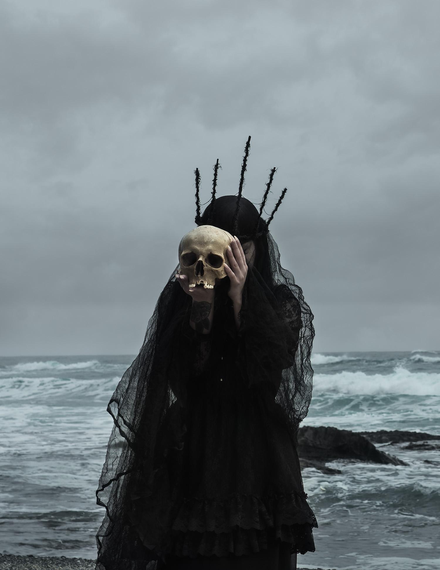 American Ghoul, Siren, dark figure holding skull over face