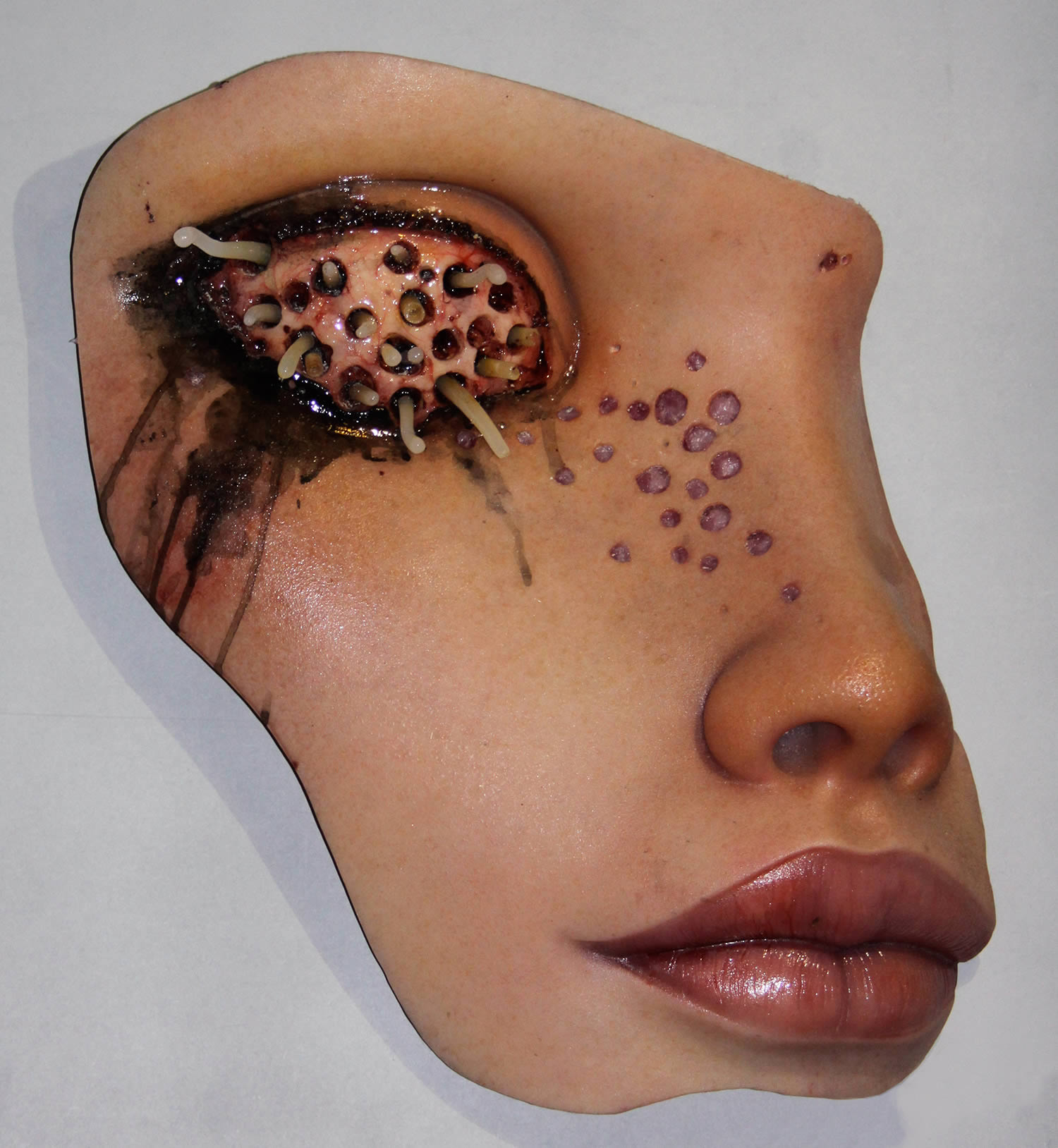 Colin Christian, Alive - sculpture of face with eye filled with worms