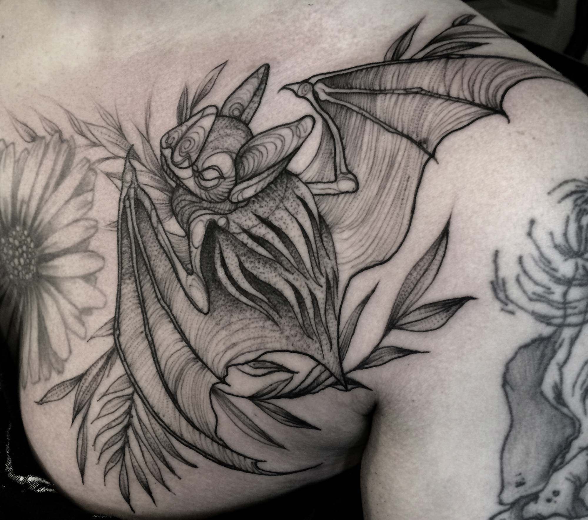 Nomi Chi bat tattoo