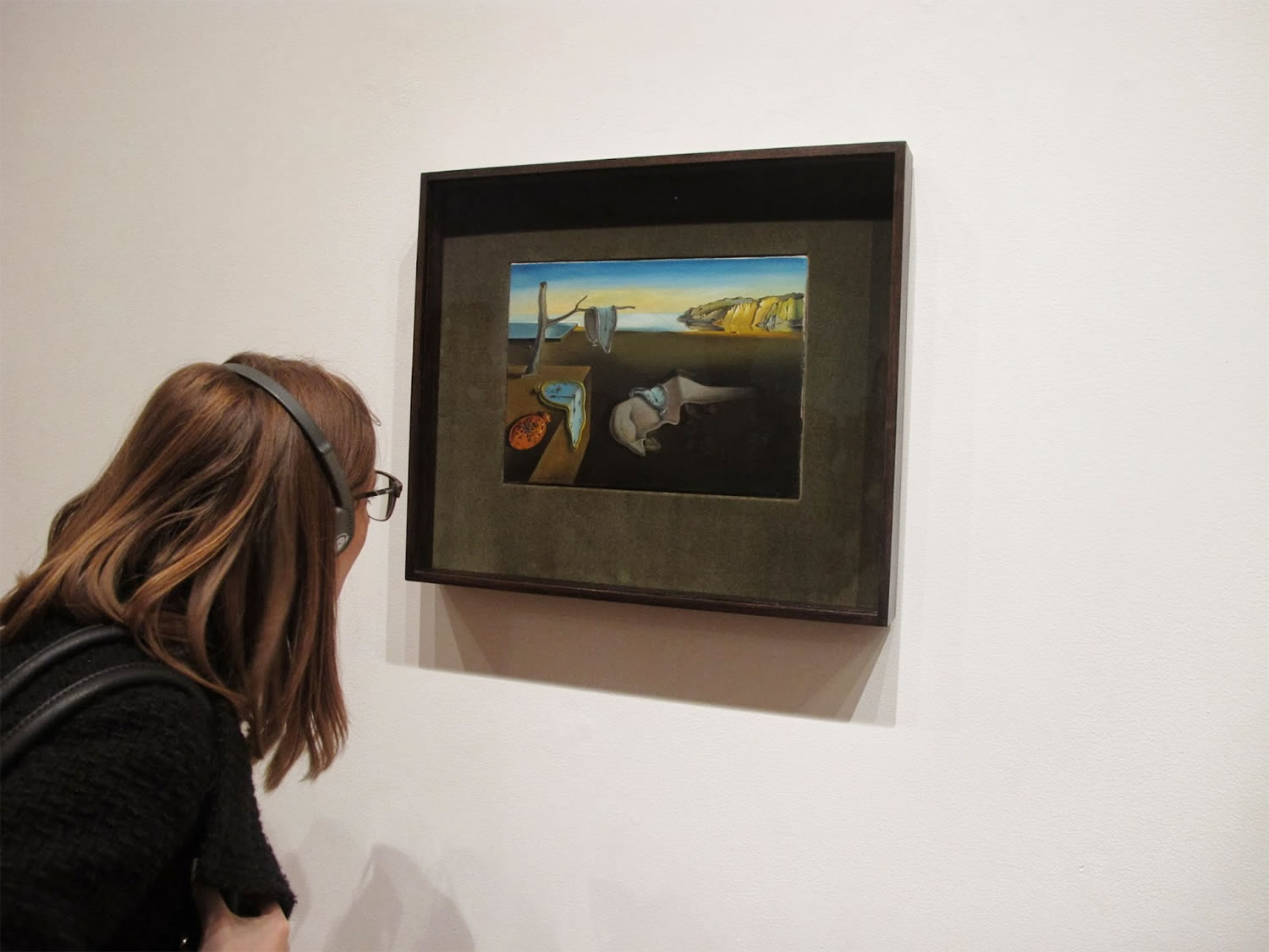 Picture of The Persistence of Memory hanging on museum wall. Photo © Christina Whiting