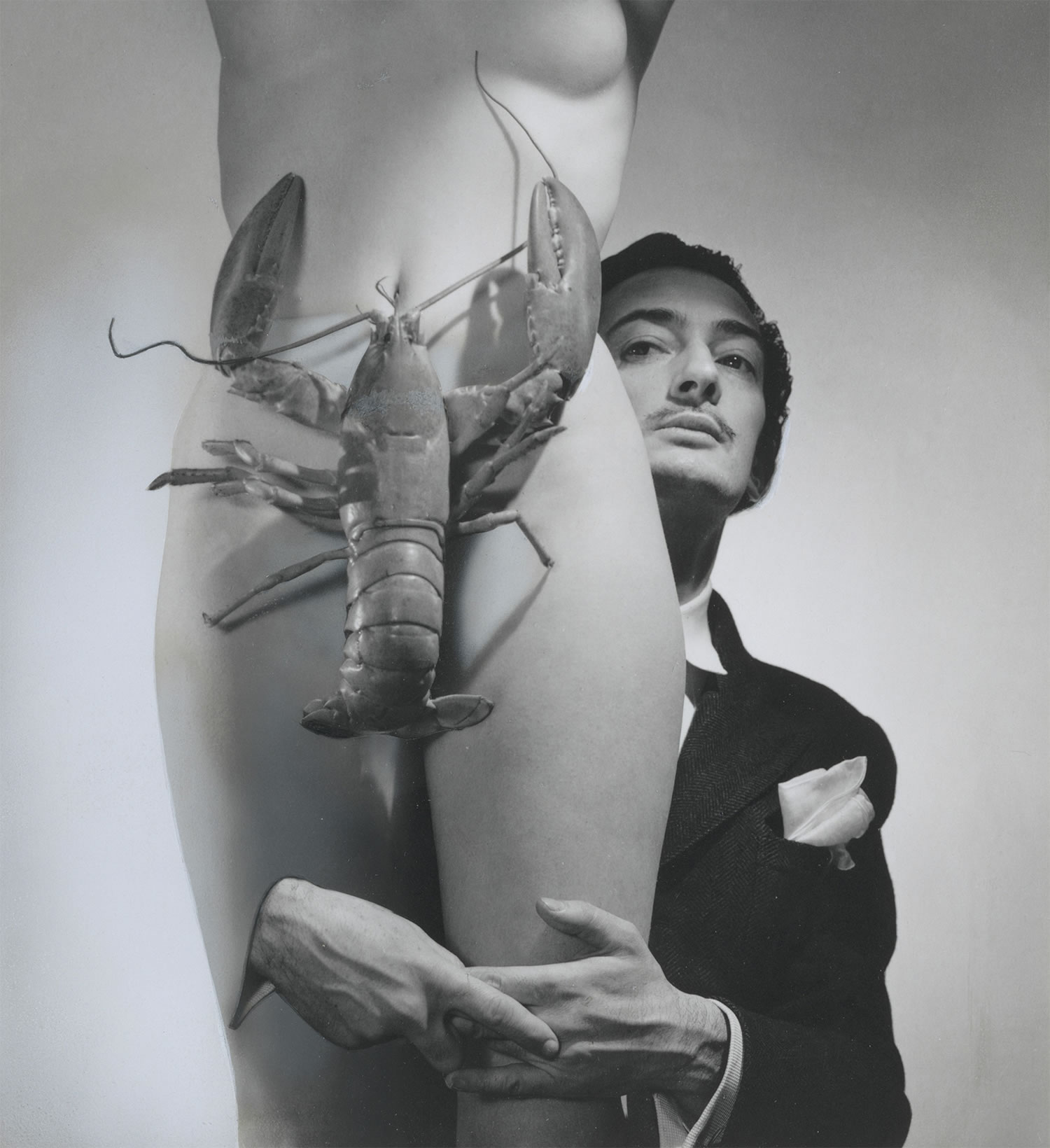 lobster covering woman, dali hidden in the back