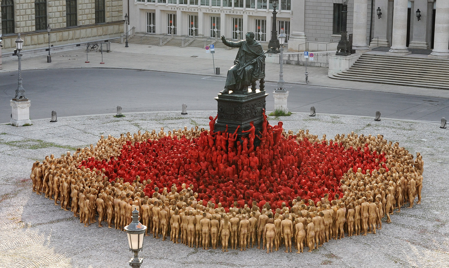 Spencer Tunick - photograph of nude body installation around statue