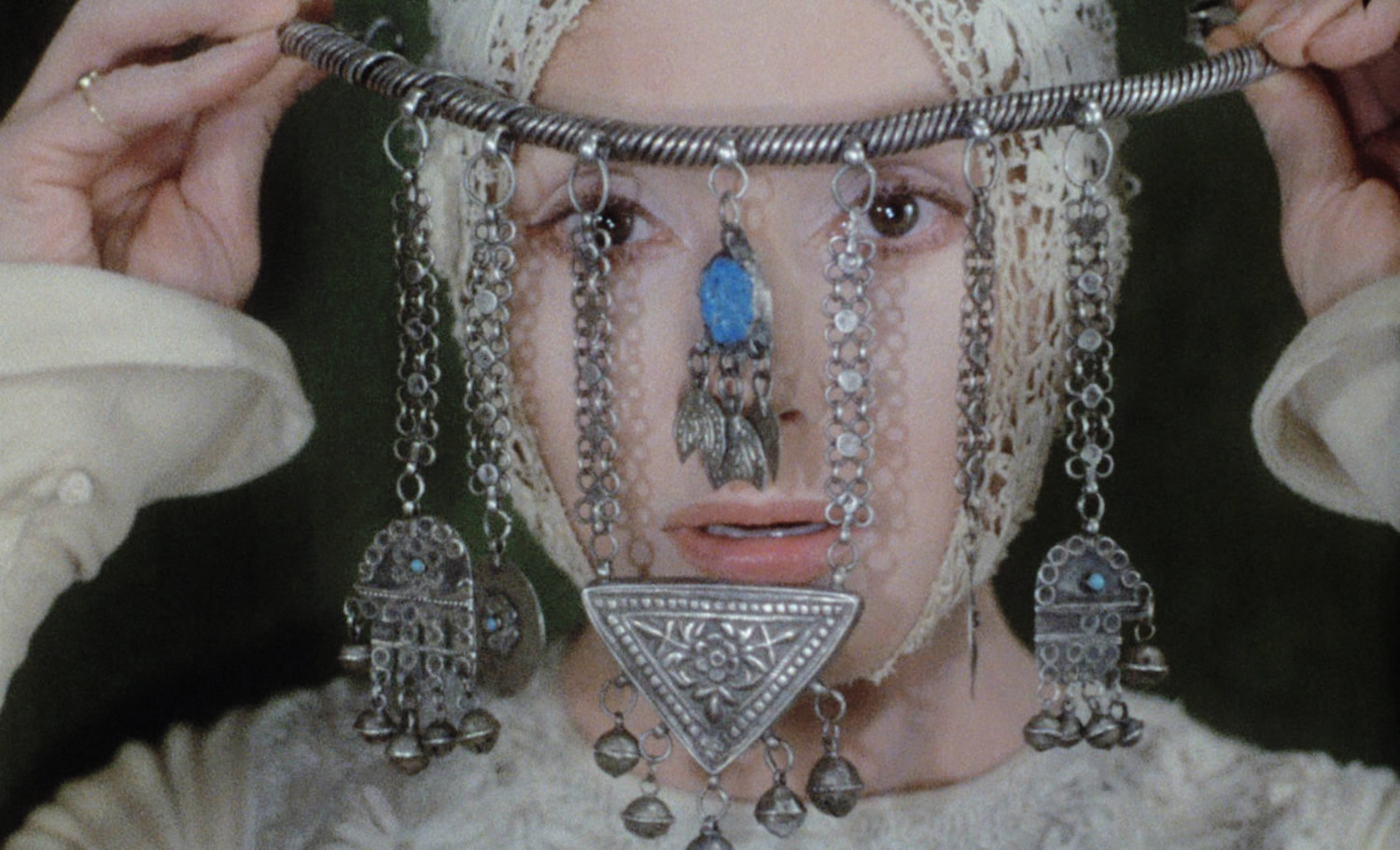 ornamented jewelry head piece, film still from blanche