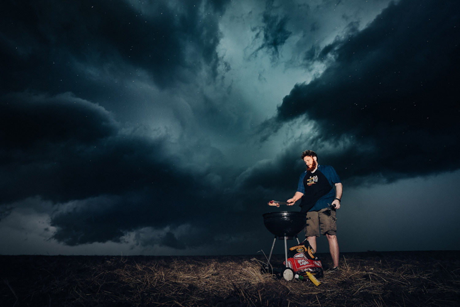 Benjamin Von Wong - man barbecuing in storm