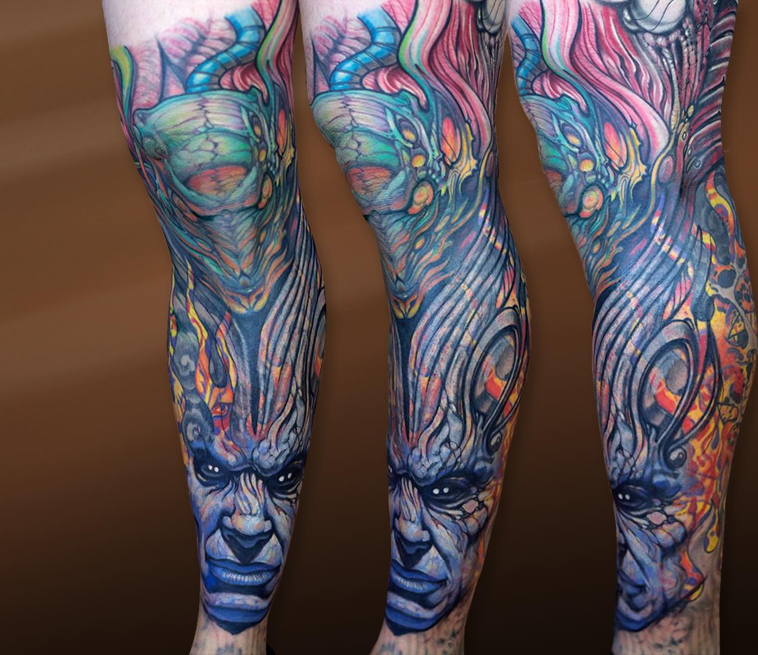 colorful surreal biomechanical tattoo on leg by paco dietz