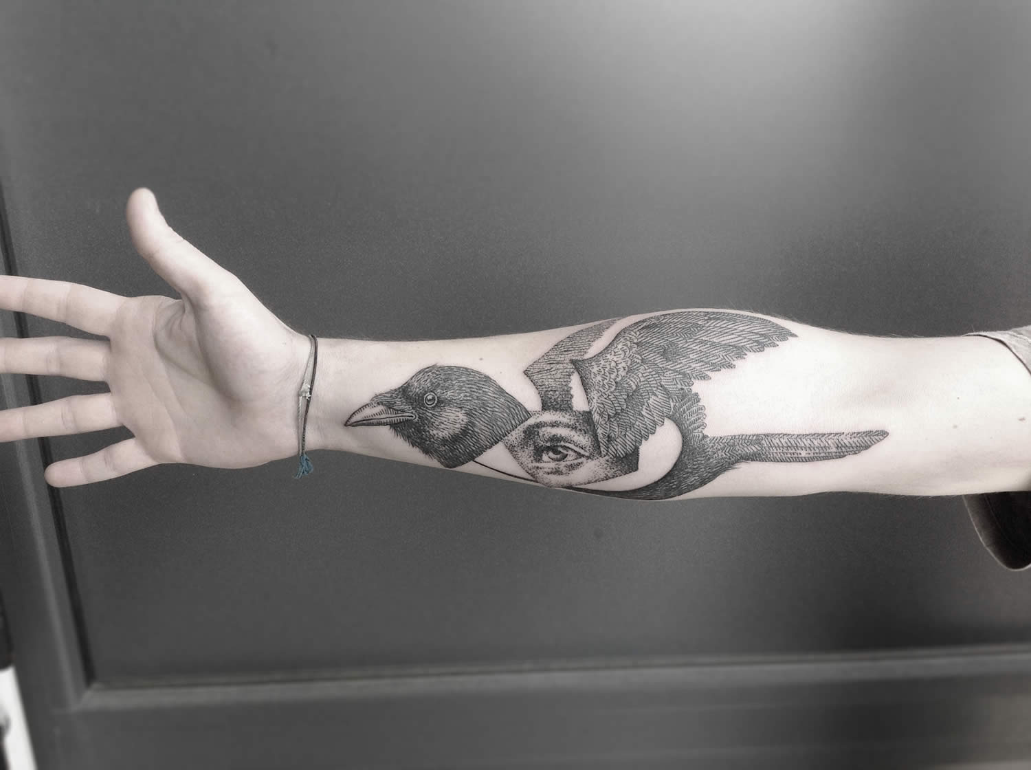 bird with eye belly, unique tattoo on arm by Ottorino D' Ambra