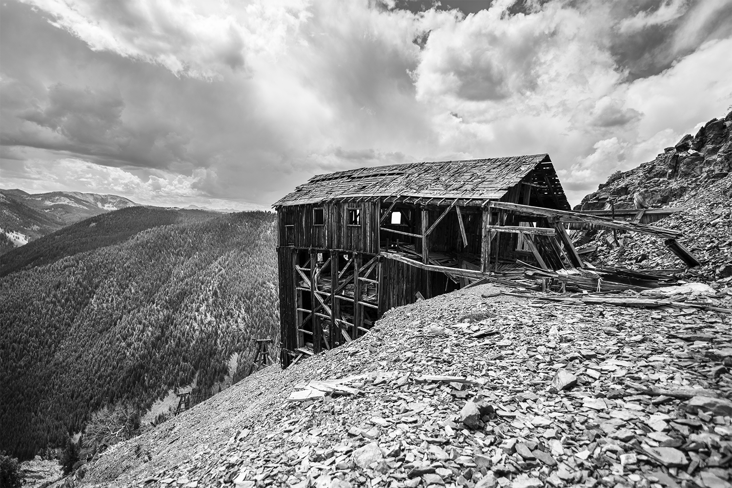 Brian Cattelle, BARE USA - Skylark Mine, ID - nude and building on cliff