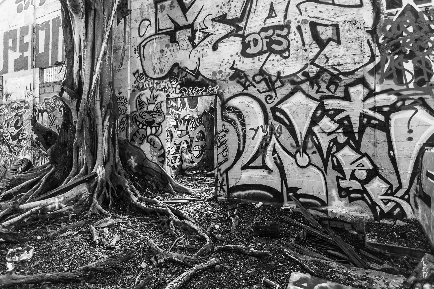 Brian Cattelle, BARE USA - Walalee Boys Industrial School, HI - nude in abandoned structure with graffiti and overgrowth