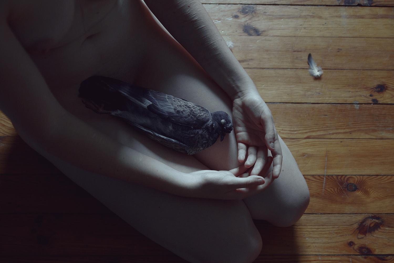 Elena Helfrecht - holding dead bird