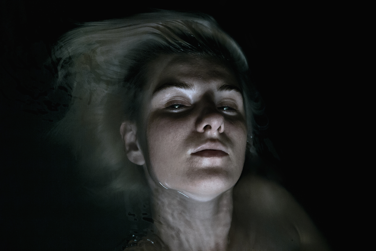 Elena Helfrecht - woman half-submerged in dark water