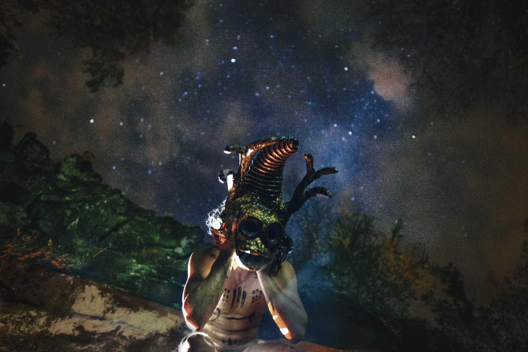 Leonard Condemine - masked figure under night sky