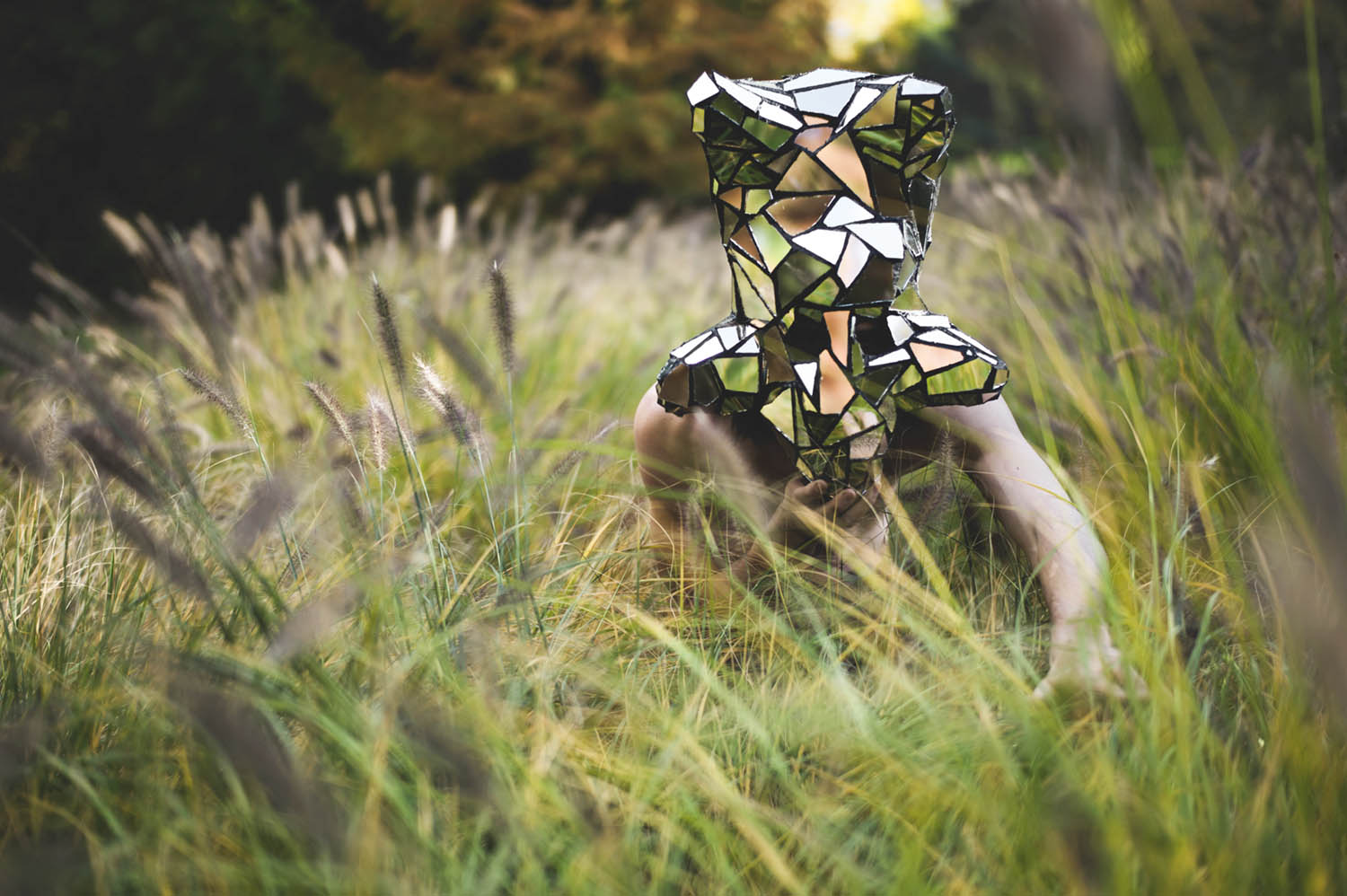 Leonard Condemine - iridescent masked figure in the grass