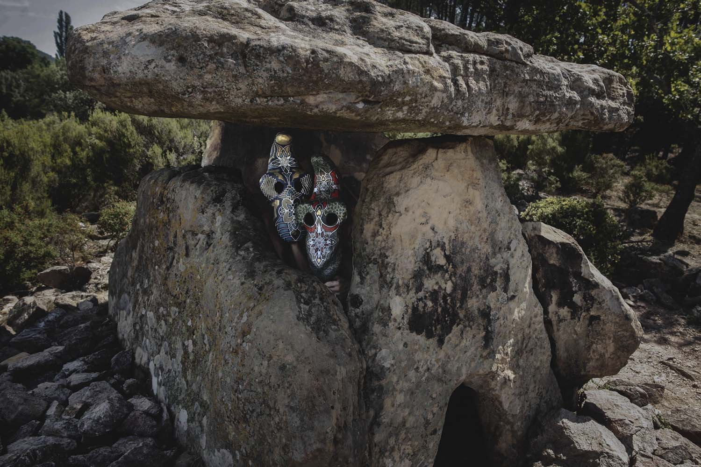 Leonard Condemine - two masked figures hiding between rocks