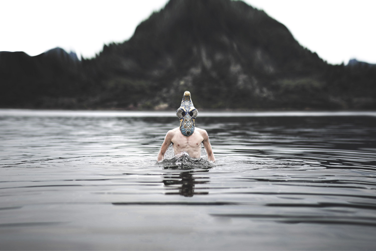 Leonard Condemine - man wearing mask standing in water