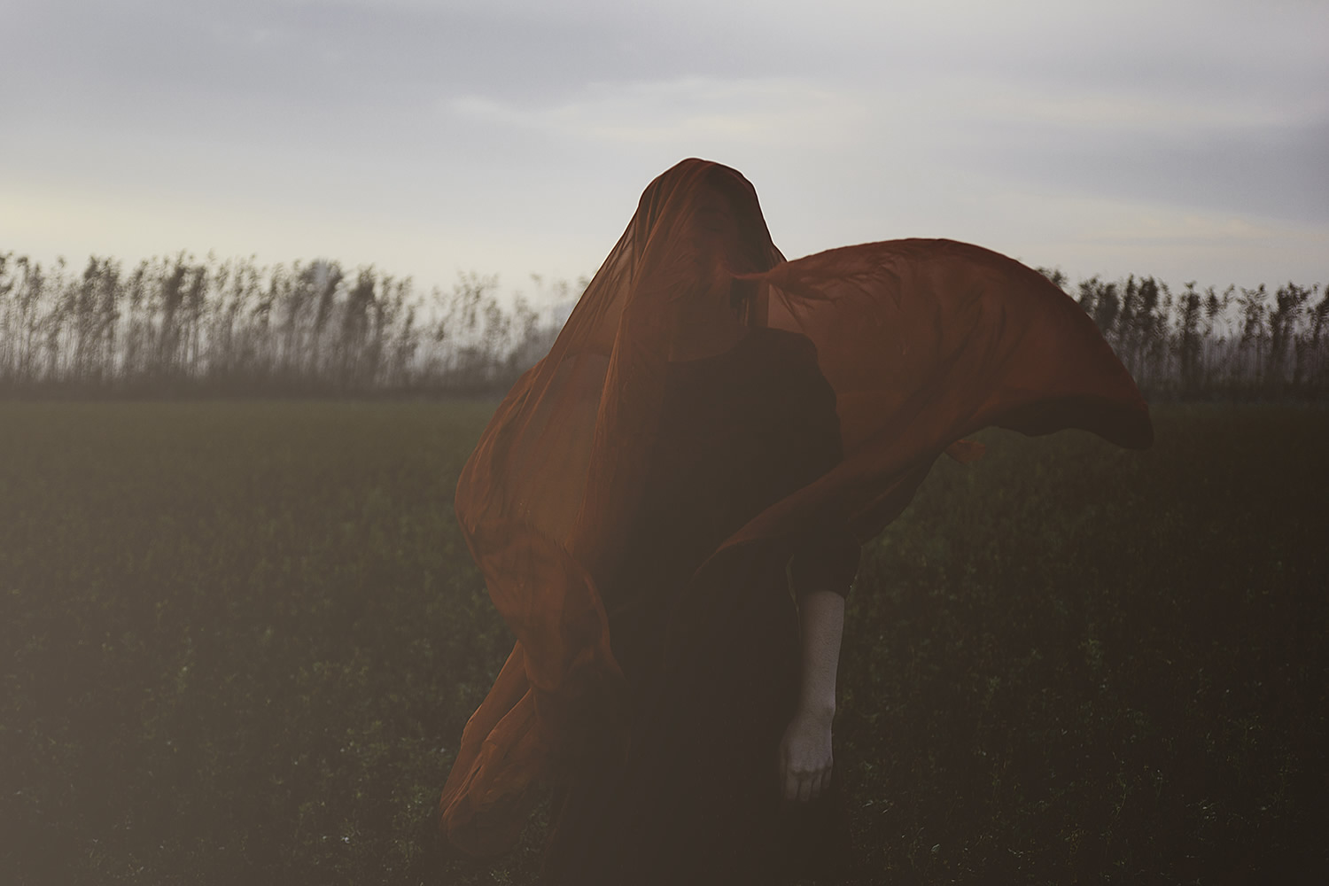 hidden under a red veil, photography by Aitor Frías & Cecilia Jiménez