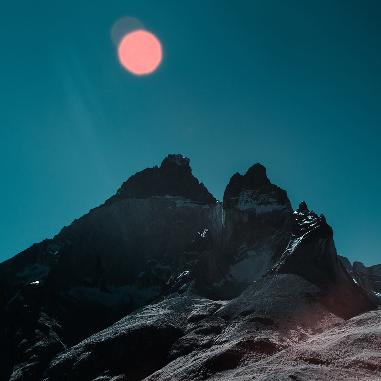 pink moon over mountains
