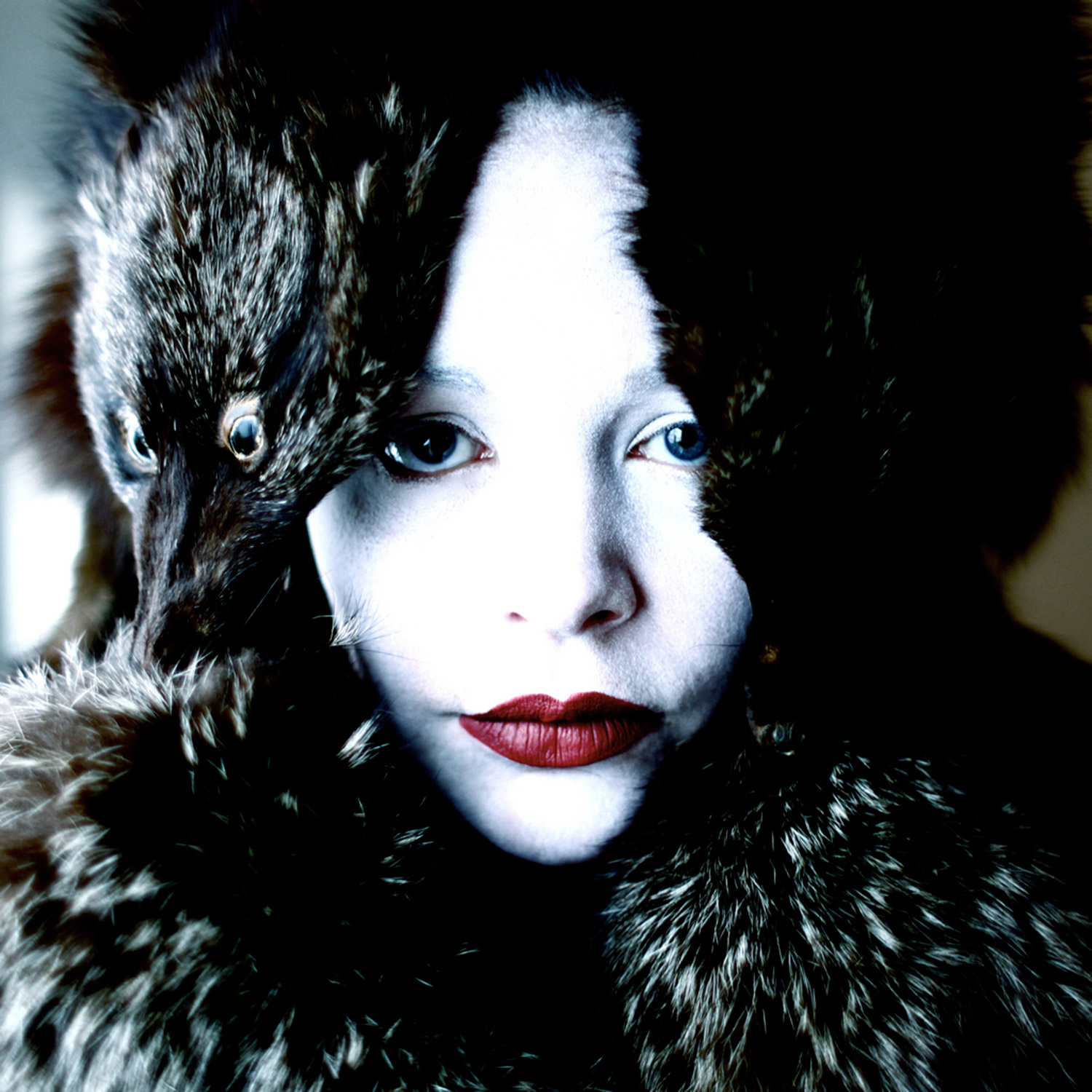 Helen Warner, Winter's Whisperer - woman with pale skin wearing fur