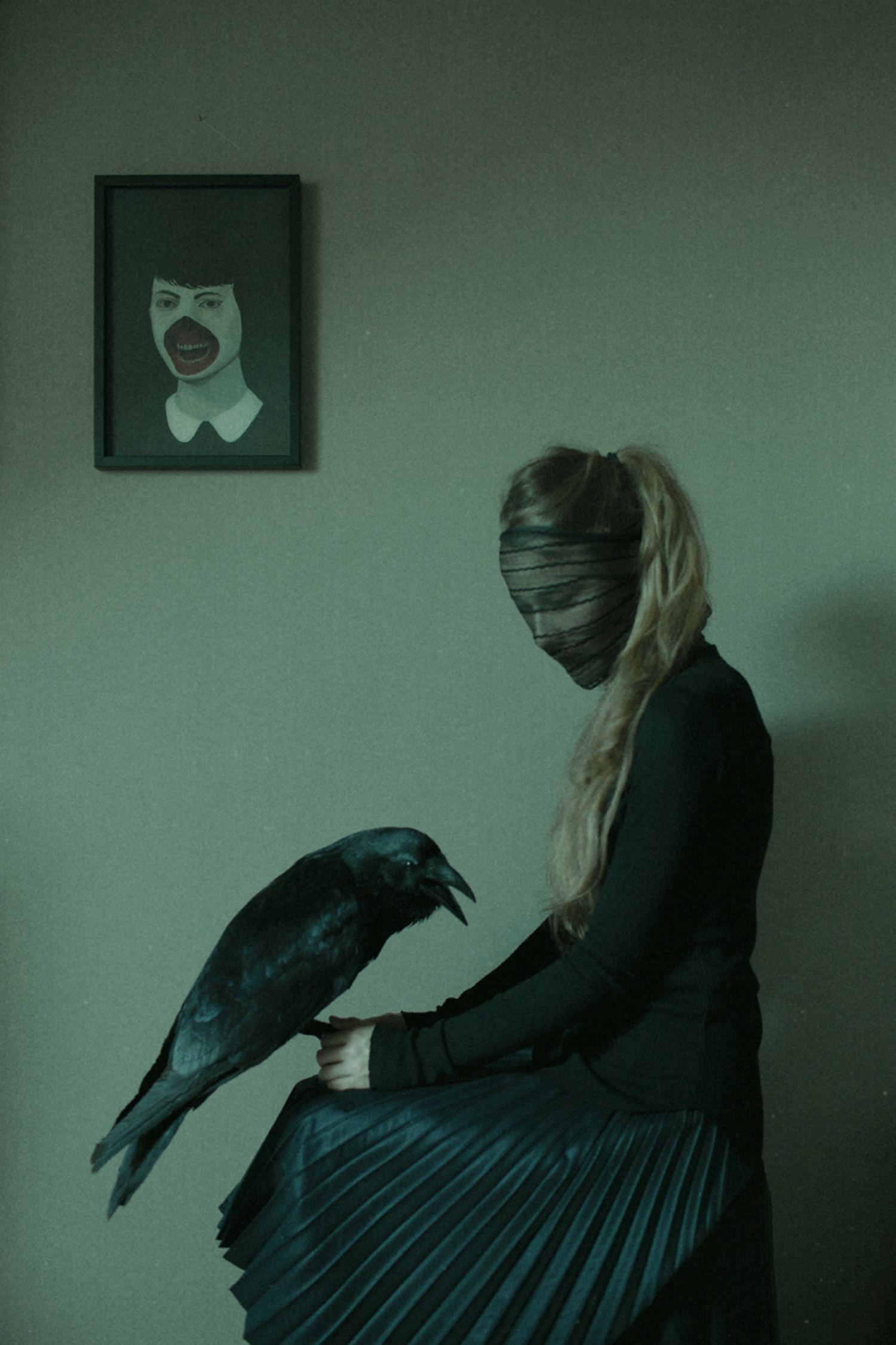 Laura Makabresku - wearing black veil and holding raven