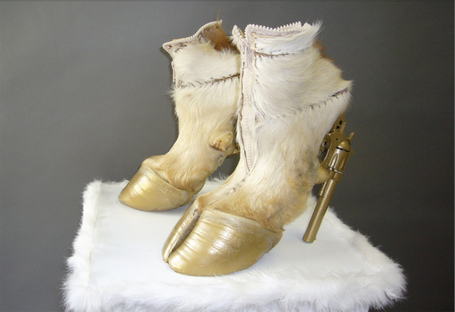 Iris Schieferstein - taxidermy couture, hoof heels with gold guns side angle